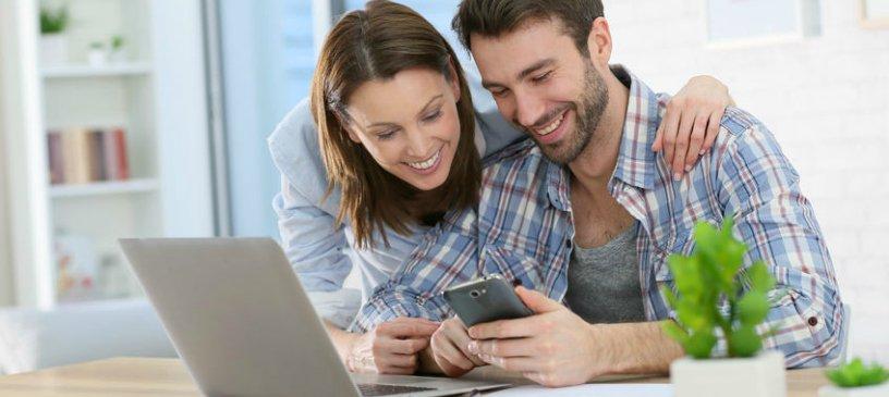 millennial couple on laptop