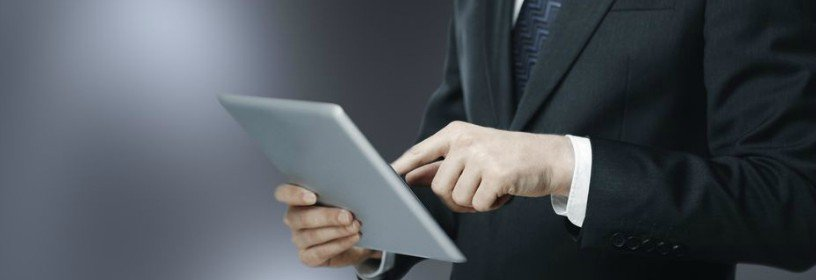 man in suit on tablet