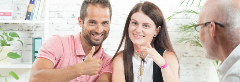 Happy man and woman holding house keys