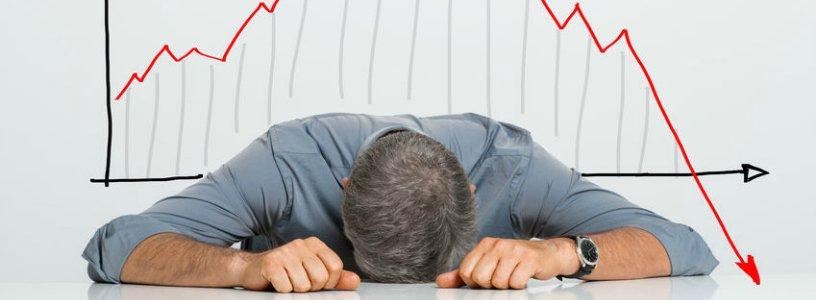 Man laying head on desk