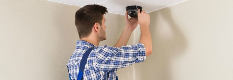 man installing home video surveillance in residence