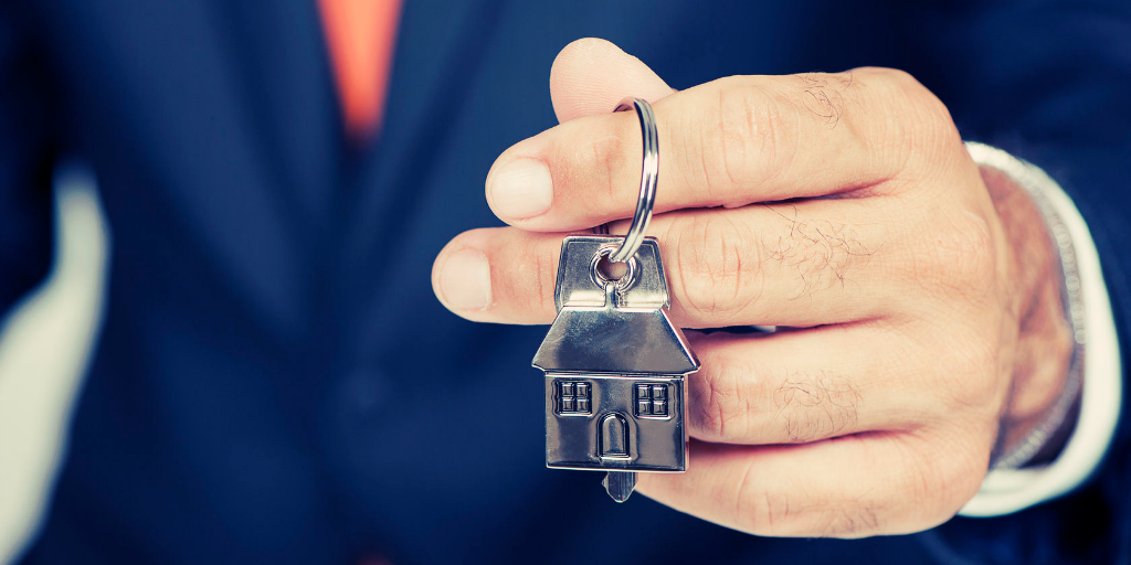 Agent holding keys to agent owned property