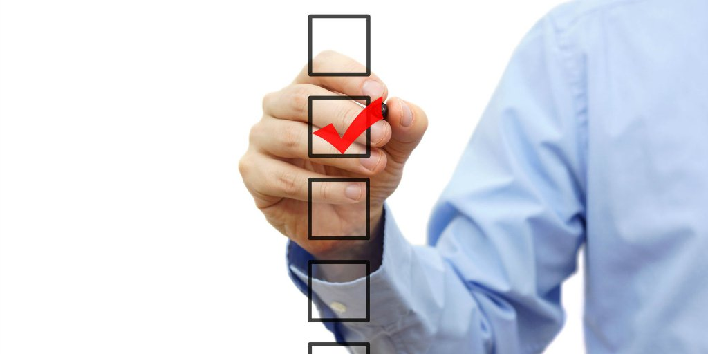 man checkmarking real estate eo options