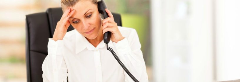 woman on phone stressed about possible real estate lawsuit