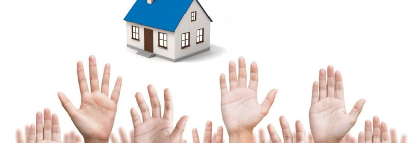 multiple hands raised reaching for house