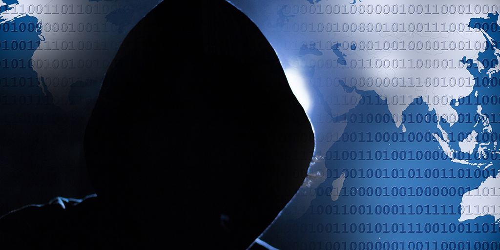 dark hooded person cyber background