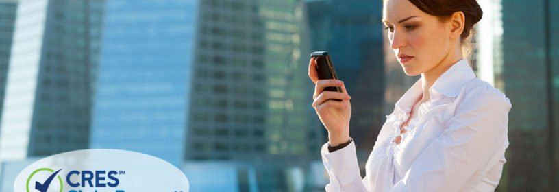 business woman using smartphone urban background