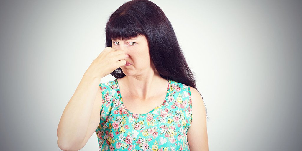 woman pinching nose at bad smell