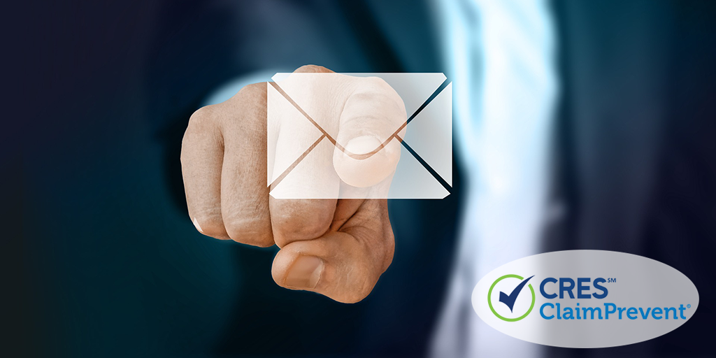 finger touching email envelope