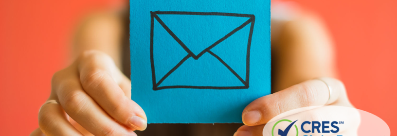 woman holding post-it note with envelope icon representing email marketing