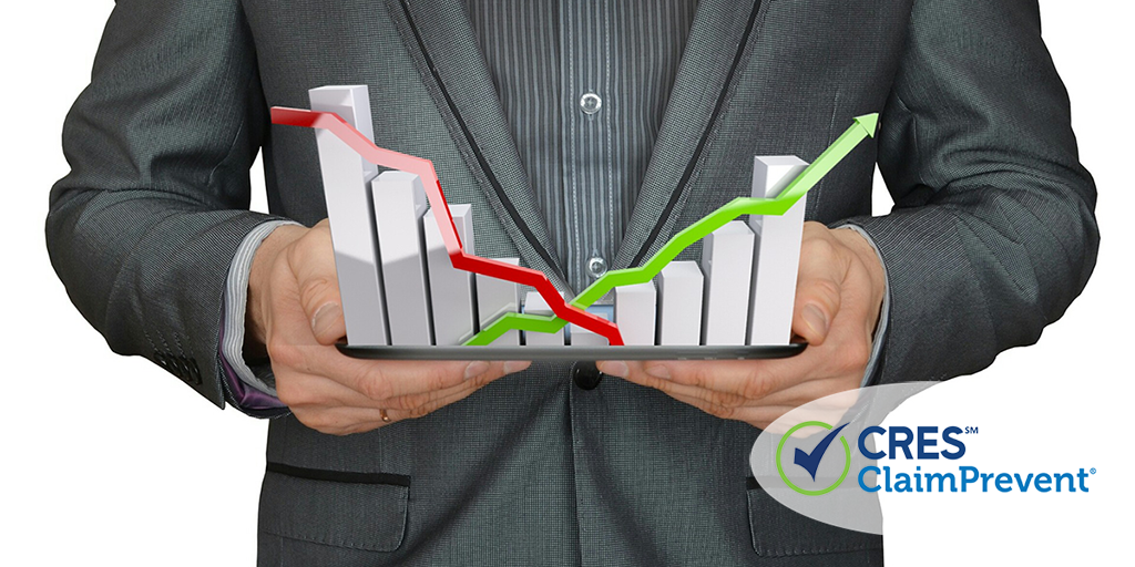 agent holding graph showing slow quarter