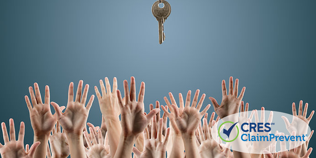 many hands reaching for one key
