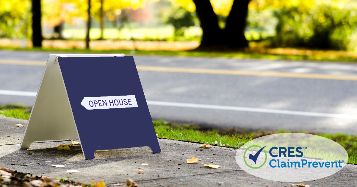 open house sign on sidewalk