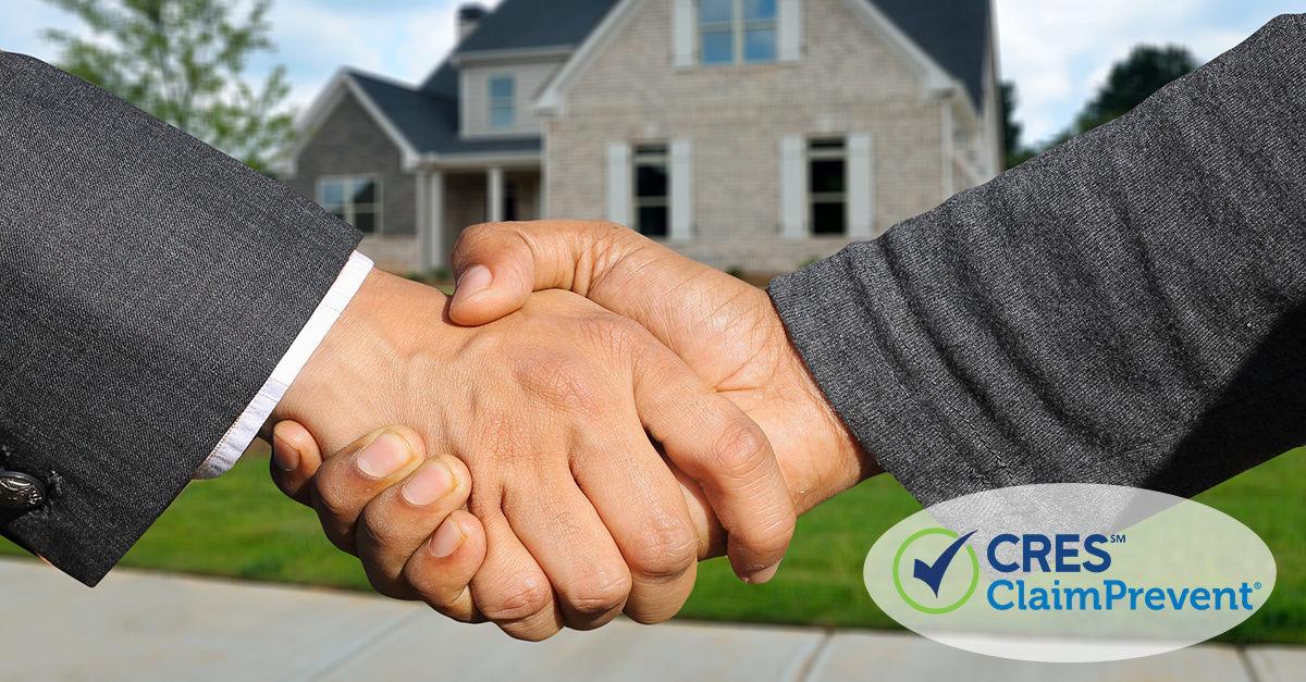 2 men shaking hands in front of house