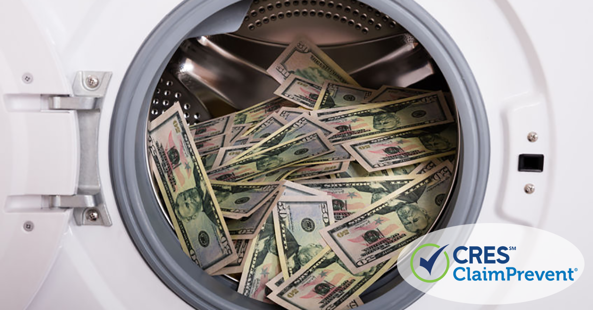 White washer with door open filled with a pile of American $50 bills
