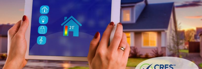 woman holding ipad up in front of house with smart home icons
