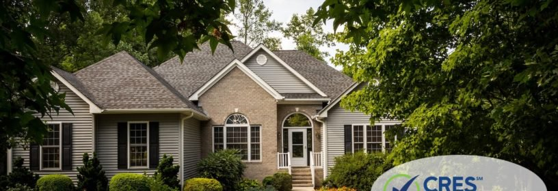 Nice tan and gray brick sided house with walkway leading up to door