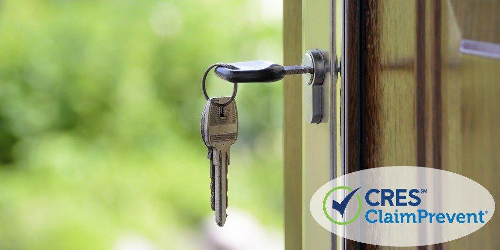 Front door with key in lock