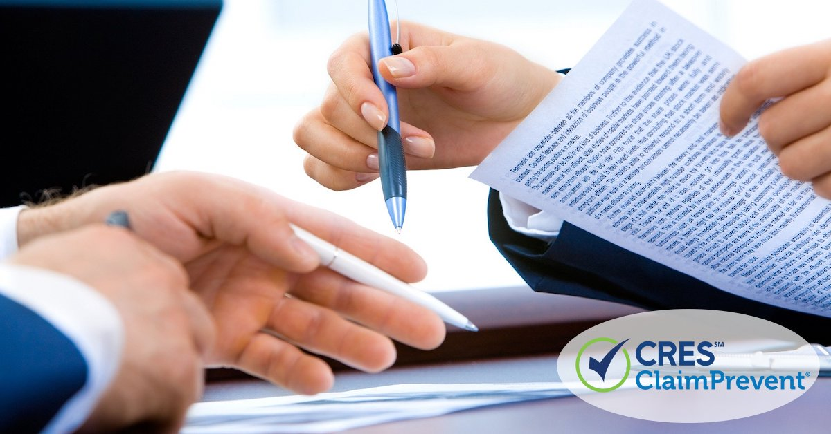 2 sets of male hands looking at legal documents with pen in hand