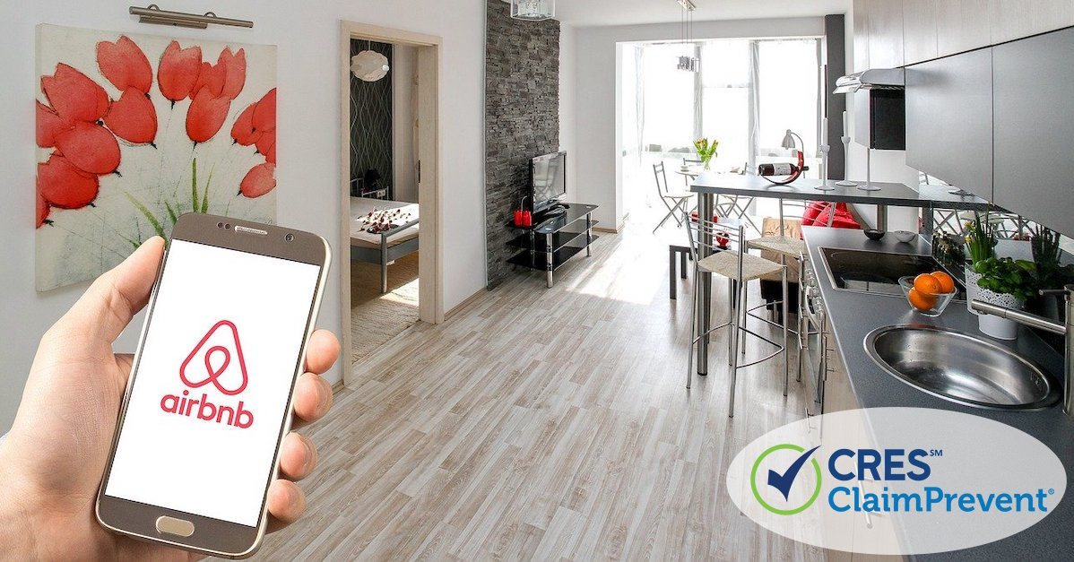 apartment property with person holding smartphone showing airbnb logo