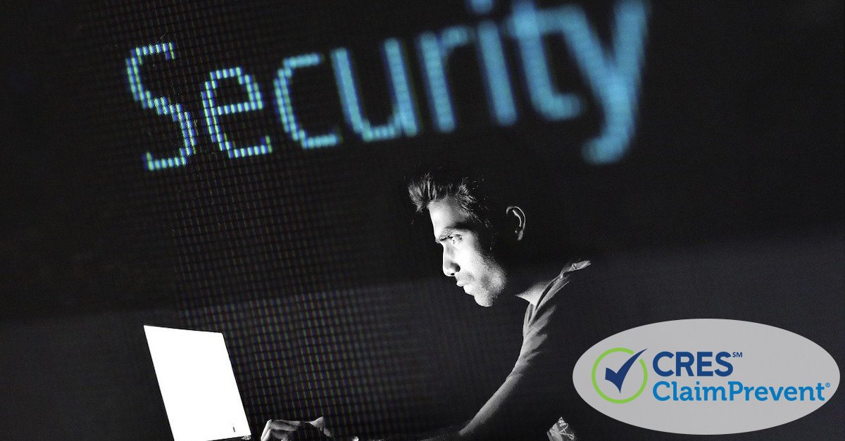 man at laptop in the dark with the word security in background