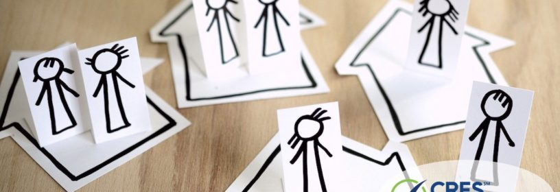 paper houses with stick people in each one
