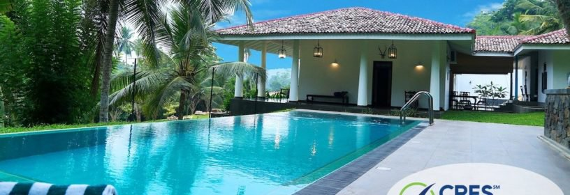 backyard of house with inground pool and palm trees