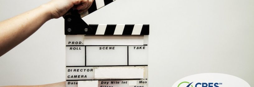 hands holding movie clapperboard
