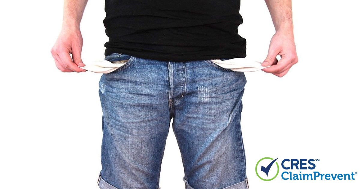 man pulling empty pockets out of shorts
