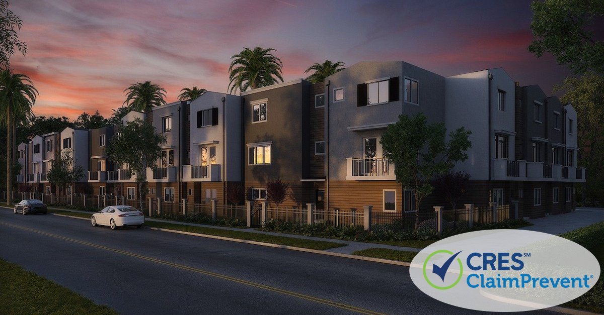 condo complex with palm trees and sunset