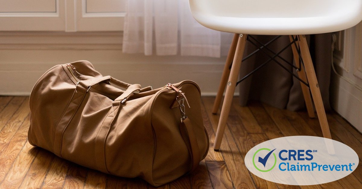 duffel bag next to chair in room