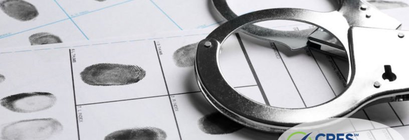 handcuffs laying on fingerprint cards