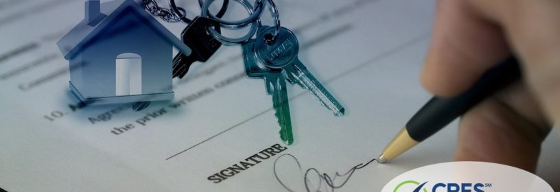 person signing house sale contract with image overlaid of house keychain and keys