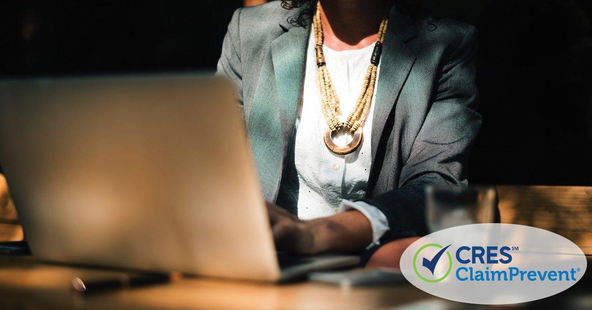 woman sitting at laptop doing work