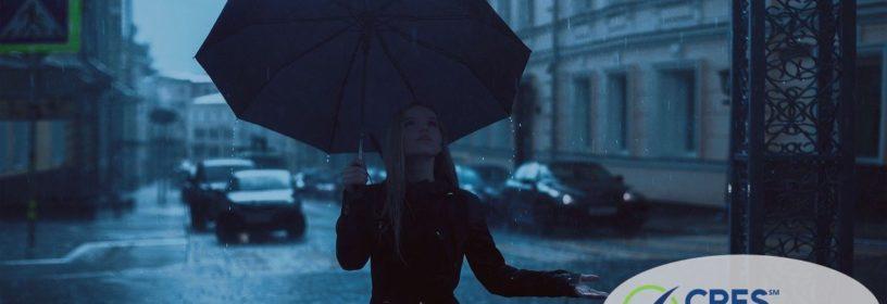 woman on street with umbrella in the rain
