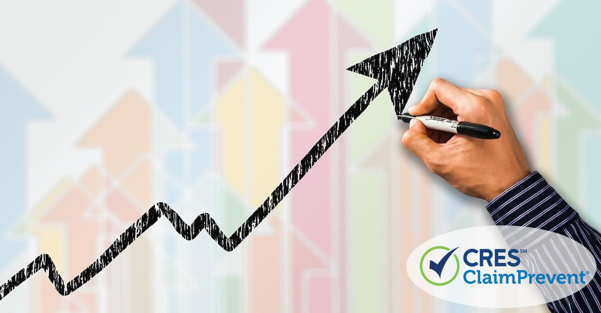 business graph arrow trending upward with person drawing in marker