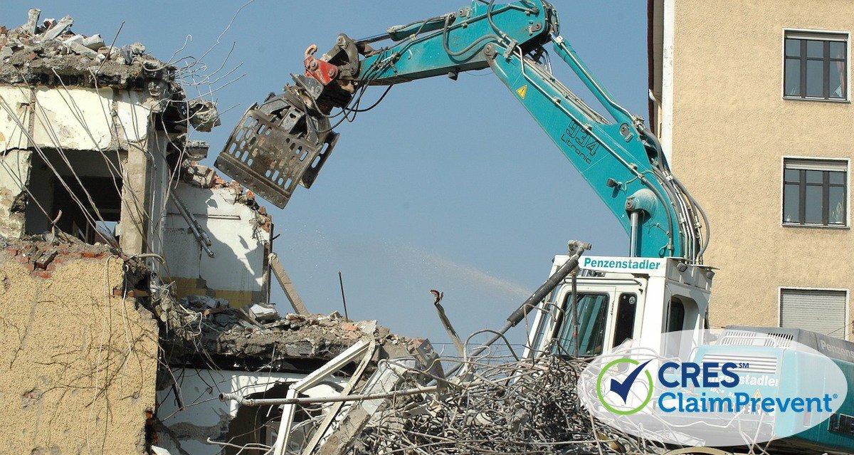 blue crane knocking down building