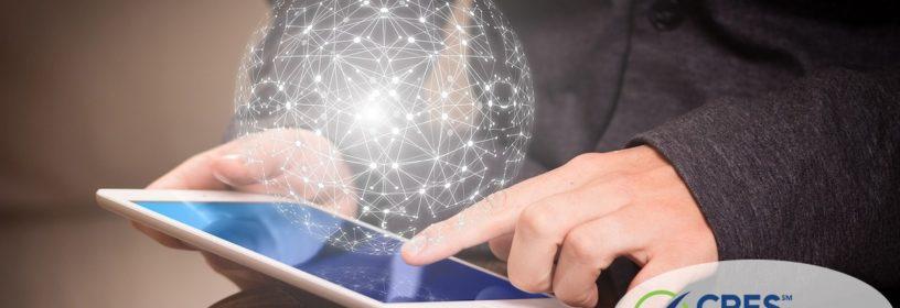 man touching ipad with world simulation image above it