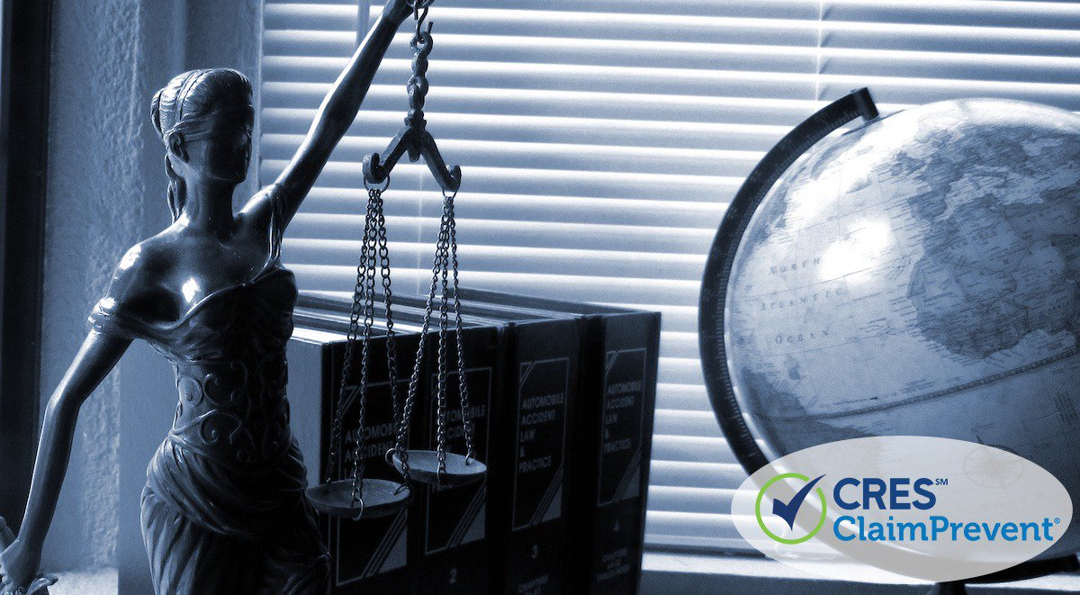 status on desk of lady justice holding scales